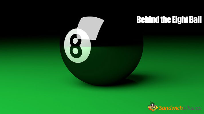 Behind the eight ball 意味